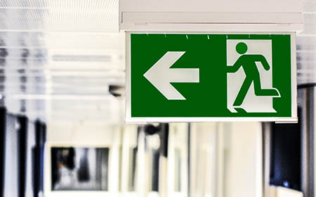 Emergency Lighting automatically illuminates when the power fails showing people the safest way to the nearest exit