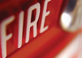 White fire alarm website category sign in a red background