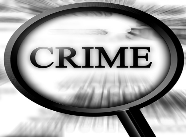 Black magnifier focusing on the word crime