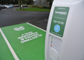 Electric vehicle commercial charging station within public parking lot